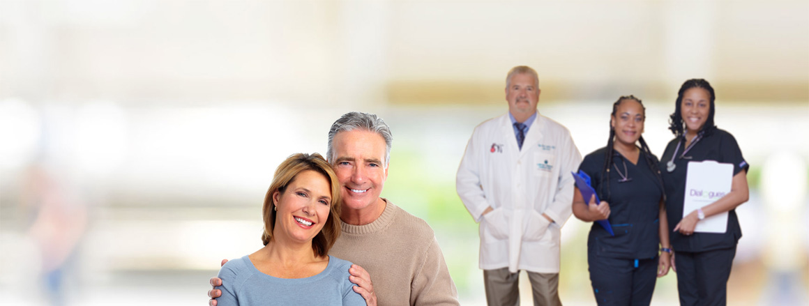 happy smiling couple with Dr. Nick Landry's medical team